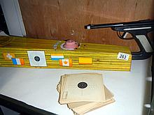 A 1950s tinplate Sports Trainer Mystery Shooting Gallery with score cards