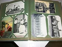 Over 100 postcards in postcard album
