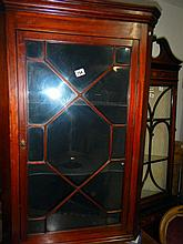 Corner cupboard with glazed door