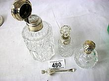 Silver topped / collared bottles and a silver scent spoon