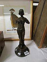 A 20th century bronze figure of a lady with garland