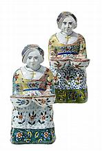 MATCHED PAIR OF FEMALE FIGURES WITH SPICE BOWLS  France or Belgium   Sand-coloured body with light-blue glaze and coloured decor.