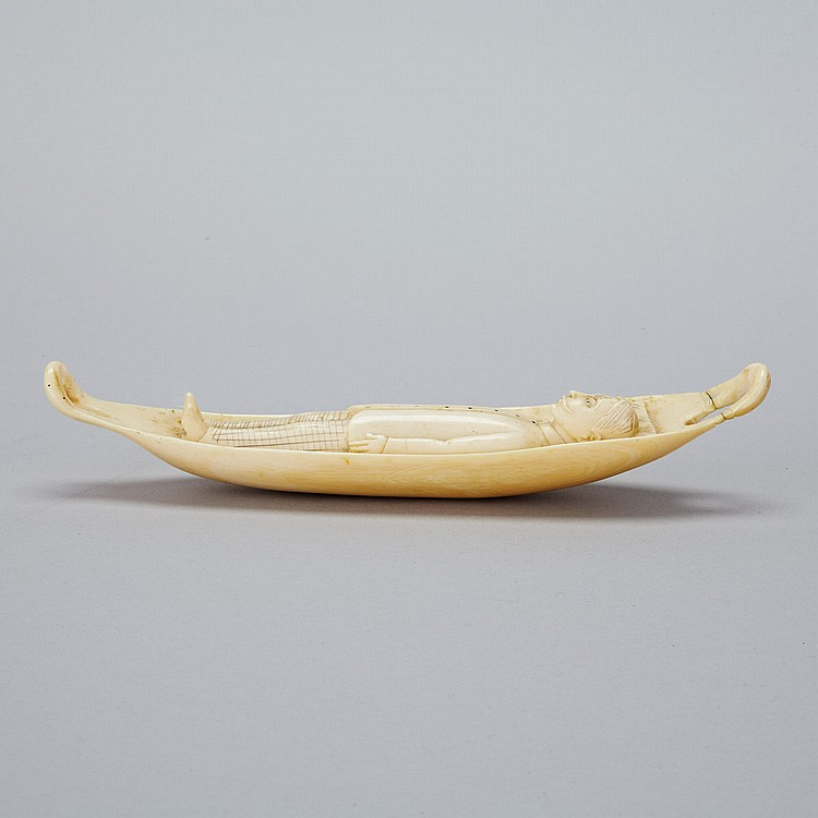 Indian Carved Ivory Figure of Gentleman Laying in Boat, 19th century, length 9.1