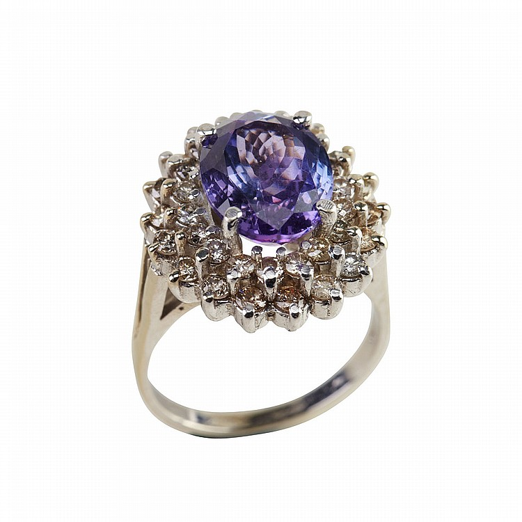 14k White Gold Ring set with an oval cut tanzanite (approx. 3.80ct.) encircled by 36 brilliant cut diamonds (approx. 0.90ct.t.w.), size 8, 8.3 grams
