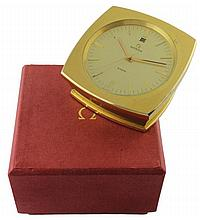 A GILT METAL OMEGA 8 DAY DESK CLOCK CIRCA 1970s IN