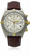 A GENTLEMAN'S STEEL & GOLD BREITLING CHRONOMAT CHRONOGRAPH WRIST WATCH CIRCA 1990s, REF. B13352 D: White dial with gilt batons, inner tachymeter bezel, triple registers recording hours, minutes & continuous seconds, date aperture. M: 17 jewel