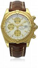 A GENTLEMAN'S 18K SOLID GOLD BREITLING CHRONOMAT EVOLUTION CHRONOGRAPH WRIST WATCH CIRCA 2005, REF. K13356 D: Silver dial with gold batons, inner tachymeter bezel, three gilt registers register recording hours, minutes & continuous seconds, date