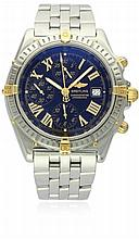 A GENTLEMAN'S STEEL & GOLD BREITLING CROSSWIND AUTOMATIC CHRONOGRAPH BRACELET WATCH DATED 2002, REF. B13355 D: Black dial with luminous inlaid gilt Roman numerals, triple register recording hours, minutes & continuous seconds, date aperture, inner