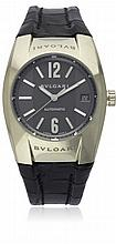 A GENTLEMAN'S 18K SOLID WHITE GOLD BULGARI ERGON WRIST WATCH DATED 2006, REF. EGW 35 G WITH ORIGINAL PAPERWORK D: Grey dial with large raised silver Arabic numerals & batons, date aperture. M: Automatic movement signed Bvlgari. C: Tonneau shape case