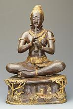 An Indonesian Bronze of a Man Playing the Flute