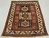 Fine colorful Kazak oriental carpet with three center geometric medallions and ivory border. 6'1