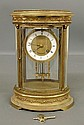 French brass and beveled glass mantle clock with porcelain dial, retailed by J.E. Caldwell, Philadelphia. As found. 11.25