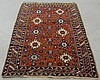 Shirvan center hall carpet, c.1900, with a red field and colorful rosettes. 5'x7'3