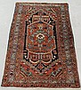 Fine Heriz oriental mat, c.1920, with an overall red field and center medallion. 4'6
