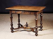 A Louis XIV Walnut Side Table.  The rectangular cl