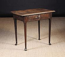 An 18th Century Oak Side Table.  The top with moul