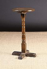 An 18th Century Provincial Candlestand.  The circu