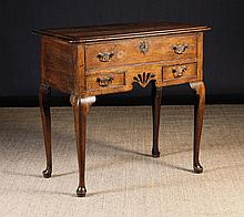 An 18th Century Oak Lowboy.  The top inlaid with a