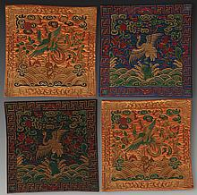 A GROUP OF FOUR CRANE EMBROIDERED ON FABRIC
