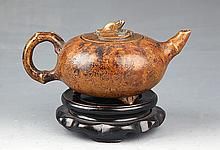 A FINE BRONZE TEA POT