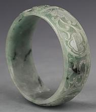 A FINELY CARVED JADEITE BANGLES
