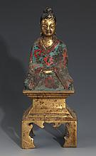 A FINELY CARVED CLOISONNÉ ENAMEL DEITY FIGURE