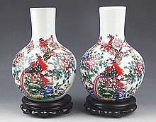 A PAIR OF FINELY PAINTED PORCELAIN BOTTLE