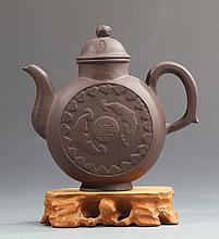 A LARGE AND FINELY CARVED YIXING ZISHA TEAPOT