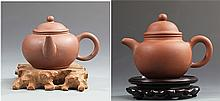 A GROUP OF TWO FINELY MADE YIXING ZISHA TEAPOT