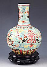 A LARGE AND COLORFUL PAINTED PORCELAIN BOTTLE