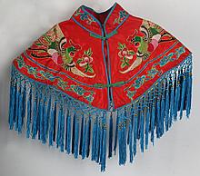 A FINELY EMBROIDERED RED COLOR WOMEN CLOTH