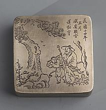 A SQUARE BRONZE STORY CARVED INK CARTRIDGE