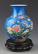 A COLORFUL PAINTED BLUE COLOR PORCELAIN BOTTLE