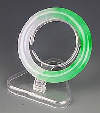 A RARE AND FINE JADEITE BANGLE
