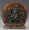 A TIBETAN BUDDHA CARVED TURQUOISE DECORATION