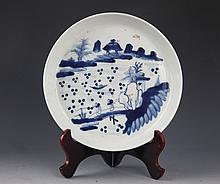 A FINELY PAINTED PORCELAIN PLATE