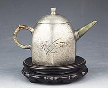 A FINE HAND MADE TIN COVERED TEA POT WITH COVER