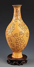 A YELLOW COLOR GLAZED FLOWER PORCELAIN BOTTLE