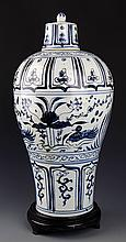 A BLUE AND WHITE PAINTED PORCELAIN JAR WITH COVER