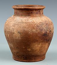 A VERY OLD CARVED POTTERY JAR