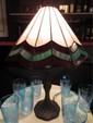 STAINED GLASS STYLE LAMP, WHITE AND GREEN GLASS SHADE WITH ANTIQUE BRONZE FINISH BASE