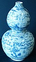 An Oriental Gourd Vase on blue and white ground