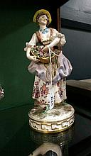 C19th German porcelain lady carrying basket of