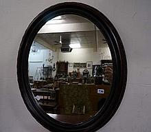 Oval mahogany framed mirror