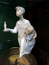 Llladro figure of boy & girl with candle