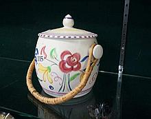 Poole pottery biscuit barrel with cane handle