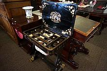 Early C19th Chinese chinoisserie laquered sewing table complete with numerous carved ivory sewing tools