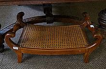 Cane seated foot stool
