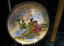 Japanese satsuma display plate of 3 Geisha girs by a screen