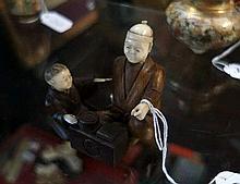 Antique Japanese ivory & wooden 7cm figure of man & child